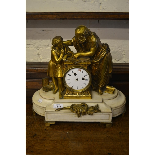 1813 - 19th Century French ormolu and marble mantel clock surmounted by figures reading from a book (moveme...
