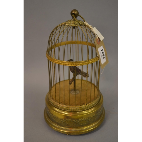 1834 - Singing bird musical automaton, the coloured feather work bird within a brass wire work circular dom...