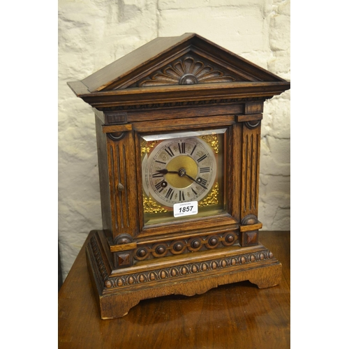 1857 - 19th Century German oak mantel clock with silvered dial, Roman numerals and two train movement...