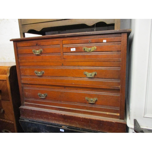 1887 - Small late Victorian walnut chest of two short and two long drawers with brass handles on a plinth b...