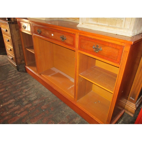 1894 - Reproduction yew wood open bookcase with three drawers above adjustable shelves...