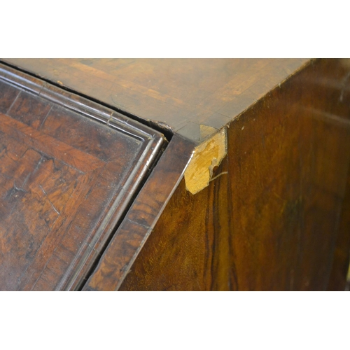 1898 - Early 18th Century walnut and herringbone crossbanded bureau, the fall front enclosing a fitted inte...