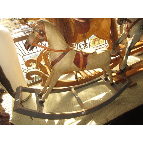 1904 - Small 19th Century vellum covered rocking horse with pine rocker...