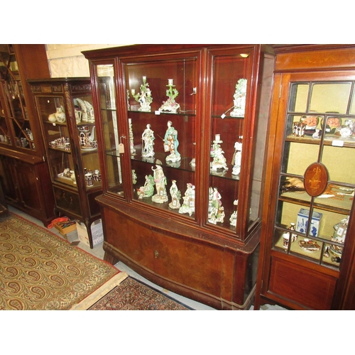 1911 - Mid 20th Century Continental stained wood and burr walnut display cabinet, the central bevelled glas...