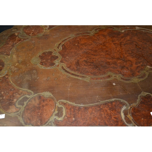 1915 - Late 19th or early 20th Century Continental cut brass and amboyna inlaid centre table, the oval shap...