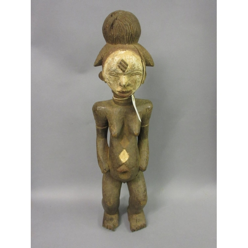 1921 - African Punu tribe carved wooden fertility figure, 66cms high...