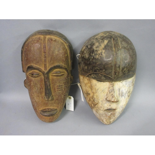 1924 - Two African Igbo tribe, carved wooden ceremonial masks...