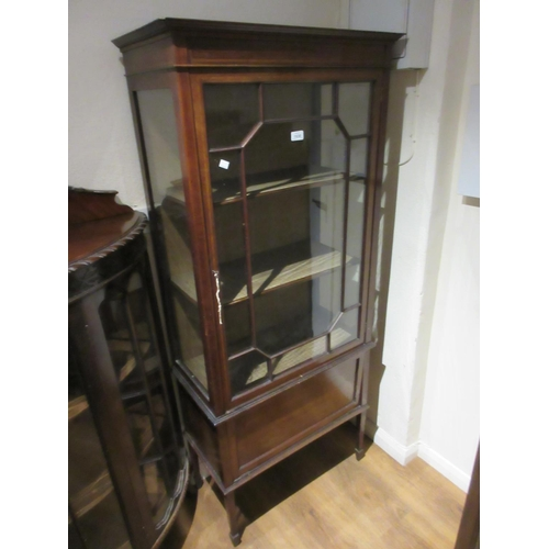 1930 - Edwardian mahogany line inlaid display cabinet, the single bar glazed door above a panelled fall fro...