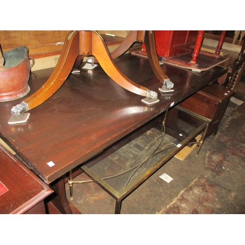 1932 - Reproduction mahogany rectangular refectory table raised on shaped slab ends with stretcher...