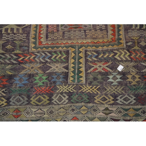 2 - Large Kelim rug decorated with two gols and all-over figures and animals, with multiple borders, 7ft...