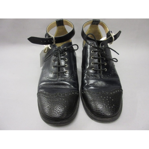 21 - Pair of Chanel ladies dark blue / black leather brogue style shoes with open sides and ankle strap, ...