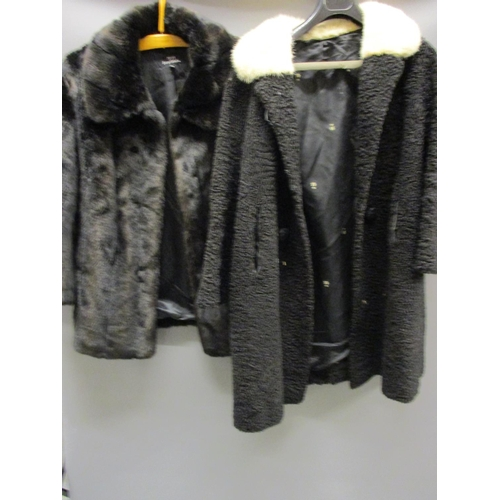 23 - Ladies three quarter length black fur coat, three quarter length mink collared black woollen coat, b...