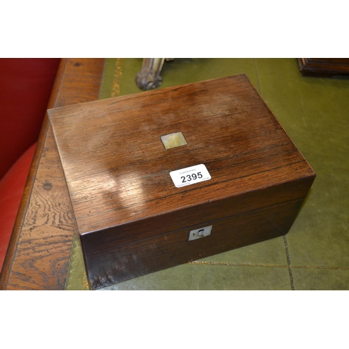 2395 - 19th Century rosewood work box, the hinged cover enclosing a silk and paper lined interior with lift...