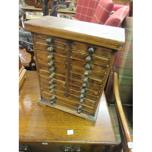 2403 - Small stained pine twenty drawer table top collector's cabinet