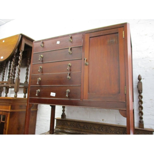 2406 - Early 20th Century mahogany music cabinet with five drawers flanked by a single panel door