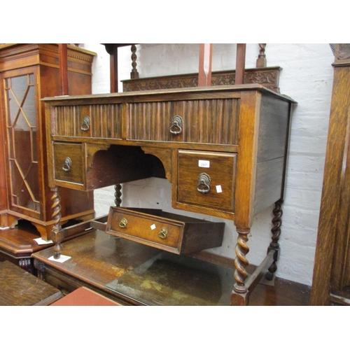 2407 - 1930's Oak bedroom suite comprising:  kneehole dressing table, single door wardrobe and a linen cupb...