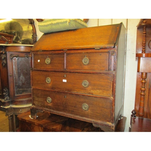 2412 - 18th Century oak bureau with a fall front enclosing a fitted interior above two short and two long d...