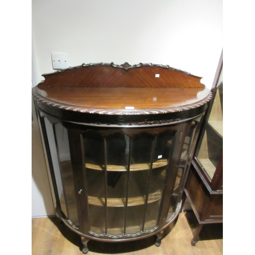 2415 - Early 20th Century mahogany bow fronted single door display cabinet on cabriole pad supports...