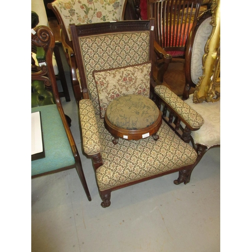 2416 - Late Victorian drawing room armchair and a Victorian walnut circular upholstered footstool...