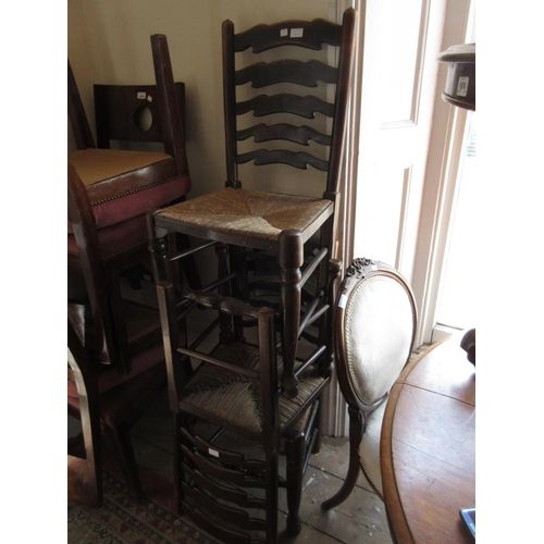2418 - Early 20th Century draw-leaf dining table, three ladderback rush seated chairs and a Continental car...