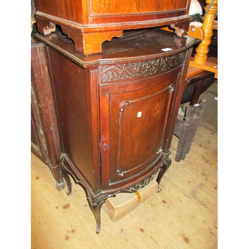 2420 - Late 19th / early 20th Century mahogany bow fronted music cabinet with cabriole supports...