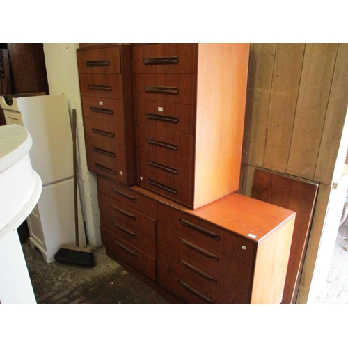 2424 - Pair of G Plan teak six drawer chests together with a similar eight drawer side cabinet...