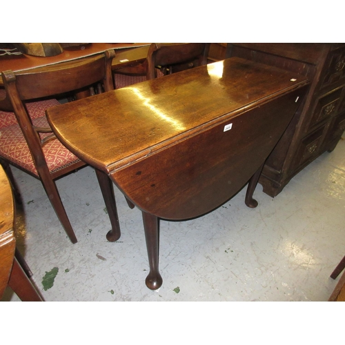 2435 - 18th Century mahogany oval drop-leaf dining table on tapering supports with pad feet...