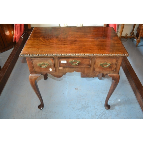 2436 - Mahogany lowboy, the gadroon carved top above three drawers, shaped frieze, cabriole supports and pa...