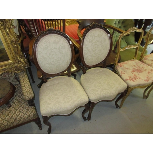 2442 - Pair of Victorian carved walnut balloon back side chairs with floral carved crestings, padded backs ...