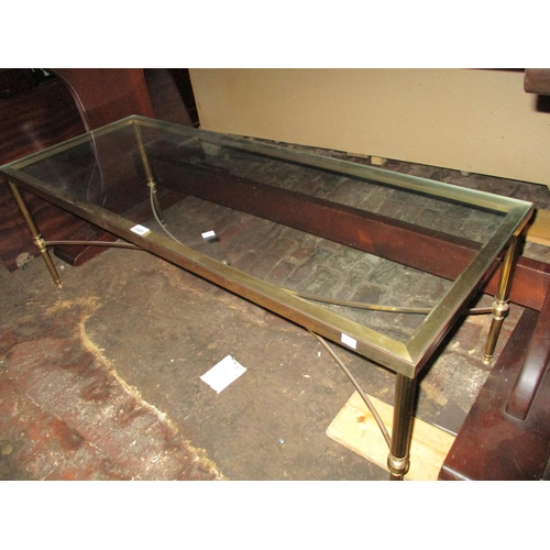 2450 - Mid 20th Century gilt brass rectangular coffee table with a glass inset top...