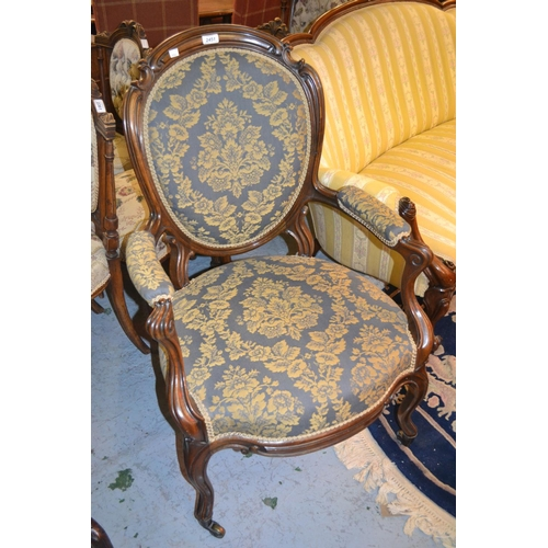 2451 - 19th Century Continental walnut open arm drawing room chair with a floral upholstered padded back, a...
