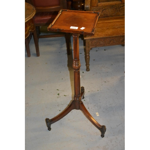 2458 - Mahogany torchere with a square dish top above a turned and fluted column support and tripod in Geor...