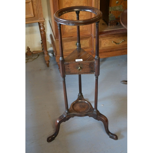 2459 - 19th Century mahogany washstand in 18th Century style, the circular moulded top above a small drawer...