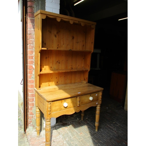 2460 - Small stripped and polished pine dresser, the boarded shelf back above a plank top, two drawers and ...