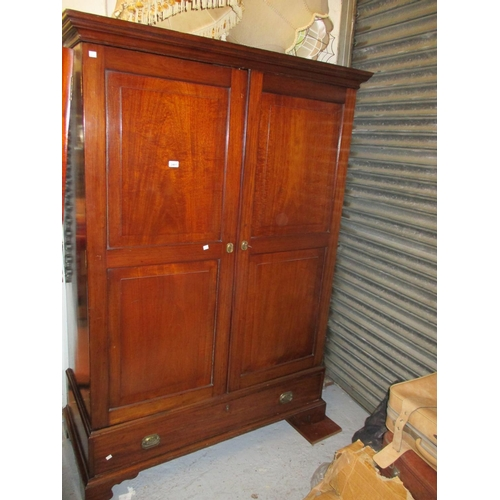 2461 - George III mahogany wardrobe, the moulded cornice above a pair of panelled doors enclosing hanging s...