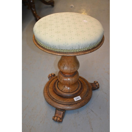 2465 - 19th Century mahogany revolving seat piano stool with a baluster turned column support and circular ...