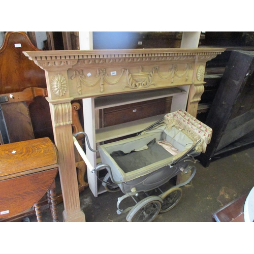 2467 - Adam style pine fire surround having carved applied urn and swag decoration...