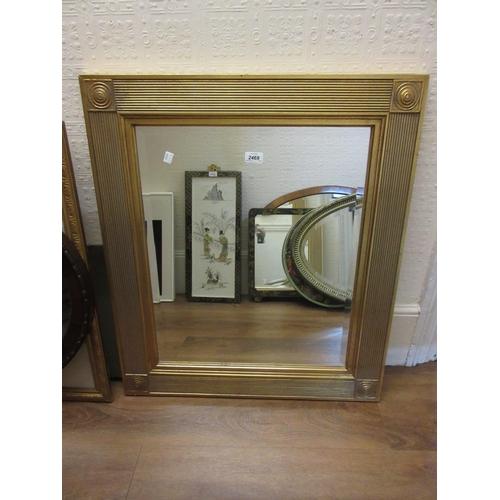 2469 - Rectangular gilt framed wall mirror having bevelled plate, 27ins x 31ins...