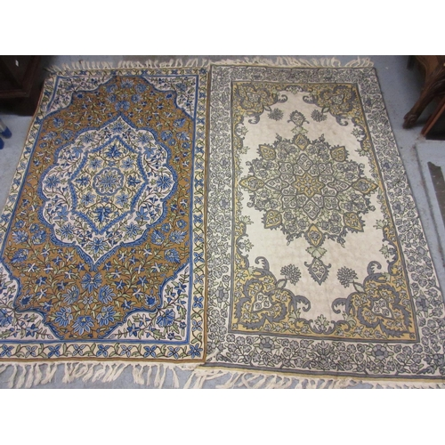 26 - Two Numdah style wall hangings with all-over floral decoration, 34ins x 60ins each...