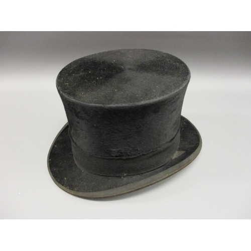 28 - Gentleman's black silk top hat...