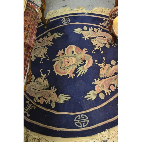 3 - Small circular Chinese rug with dragon design on Royal blue ground, 48ins diameter approximately...