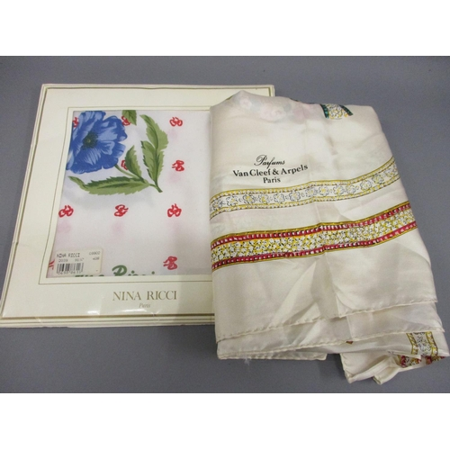 40 - Nina Ricci, Paris, silk scarf in original packaging, together with a Van Cleef & Arpels silk scarf...
