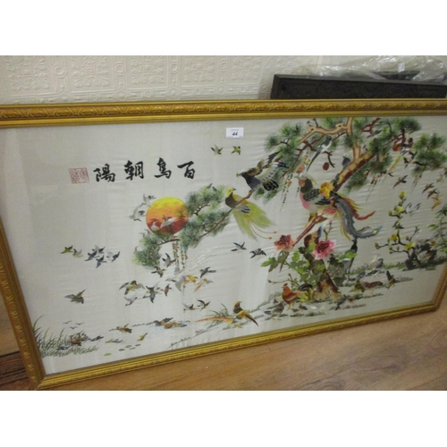 44 - Chinese silk embroidered picture, various exotic birds, 25ins x 47ins, gilt framed...