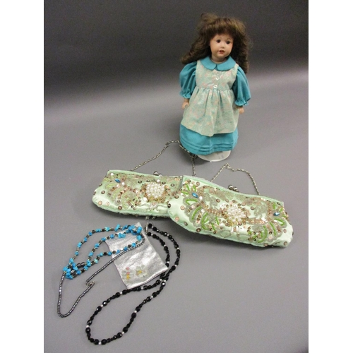 45 - Pair of green silk sequinned and beaded ladies evening purses, small bag containing a quantity of co...