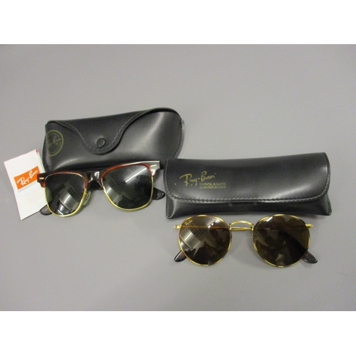 48 - Two pairs of Ray-Ban Wayfarer sunglasses in original cases...