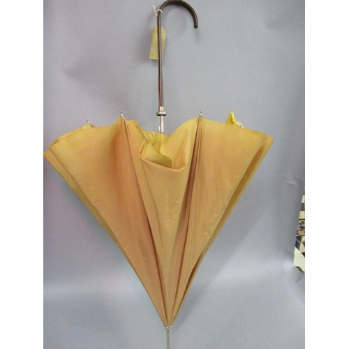 49A - Mid 20th Century ladies umbrella with leather handle, together with two other umbrellas...