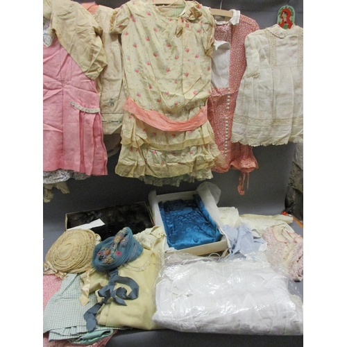 55 - Quantity of various 1930's childrens clothing, two fur muffs, together with a blouse made with Liber...