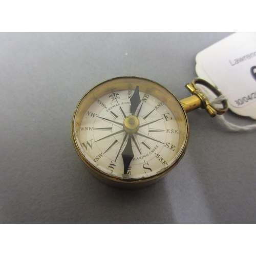 68 - Late 18th / early 19th Century gilt brass cased compass, the enamel dial inscribed Thomas Jones, Cha...