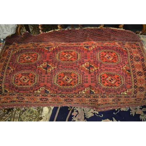 7 - Early Tekke rug with two rows of three gols on a wine ground with multiple borders and skirt panel, ...