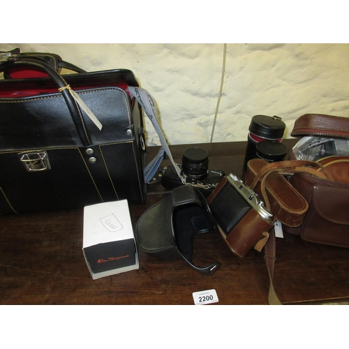 74 - Praktica SLR camera outfit including various lenses, booklets and accessories in a simulated leather...